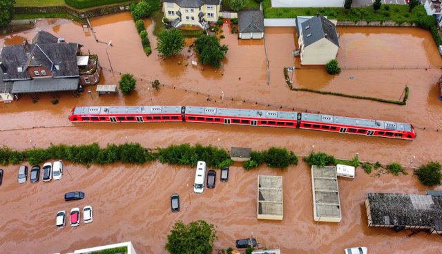15 July 2021, Rhineland-Palatinate, Kordel: An aerial view shows a regional train is submerged in water at the local station after raging floods engulfed parts of western Germany. Photo: Sebastian Schmitt/dpa