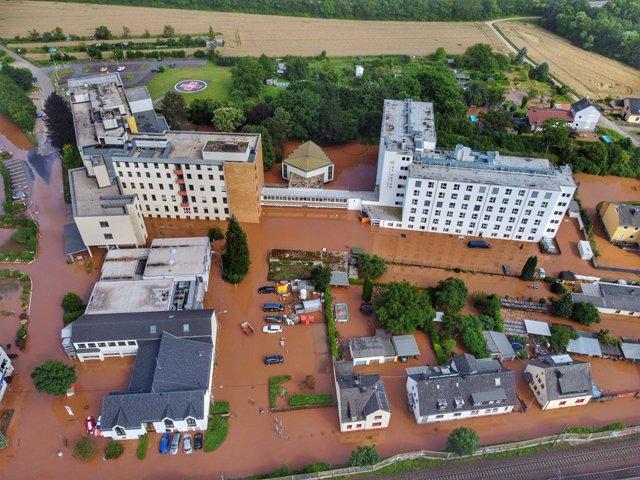15 July 2021, North Rhine-Westphalia, Trier: An aerial view shows the Mutterhaus Ehrang hospital under water after raging floods engulfed parts of western Germany. Photo: Sebastian Schmitt/dpa