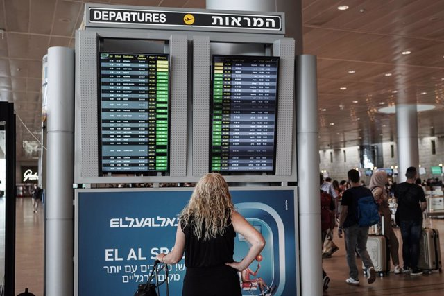 23 June 2021, Israel, Lod: A traveller checks departure information on a display screen at Tel Aviv's Ben Gurion International Airport, where all incoming travellers are tested for COVID-19. Israel has reimposed some coronavirus restrictions after a spike