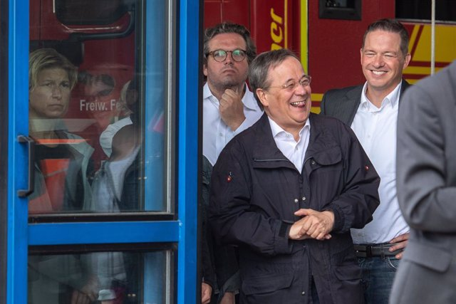 17 July 2021, North Rhine-Westphalia, Erftstadt: Armin Laschet, Minister President of North Rhine-Westphalia and candidate for chancellor, laughs while German President Frank-Walter Steinmeier give a press after visitng the fire brigade control centre in
