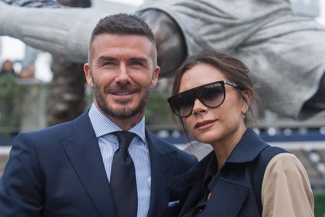 Archivo - 02 March 2019, US, Carson: Former British footballer David Beckham (L) and his wife Victoria Beckham pose for a picture during the LA Galaxy unveiling ceremony of a his statue at Dignity Health Sports Park. Photo: Javier Rojas/Prensa Internacion