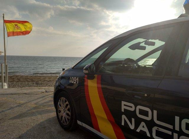 Archivo - Un Policía Nacional franco rescata en una playa a un sexagenario que no podía salir del agua