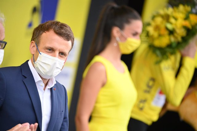 15 July 2021, France, Luz Ardiden: French President Emmanuel Macron attends the awards ceremony of the eighteenth stage of the 108th edition of the Tour de France cycling race, 129.7 km from Pau to Luz Ardiden. Photo: David Stockman/BELGA/dpa