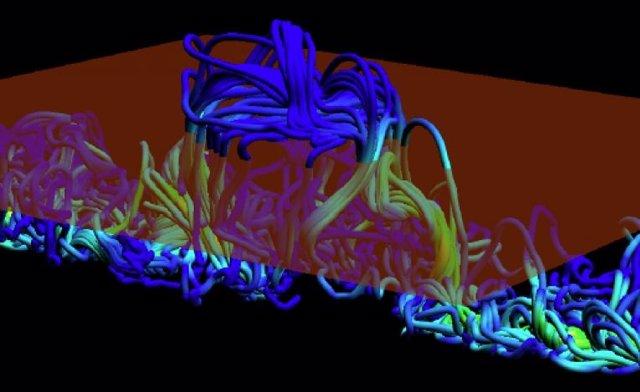 Simulación de líneas de campo magnético retorcidas que emergen a través de la fotosfera, la superficie visible del Sol.