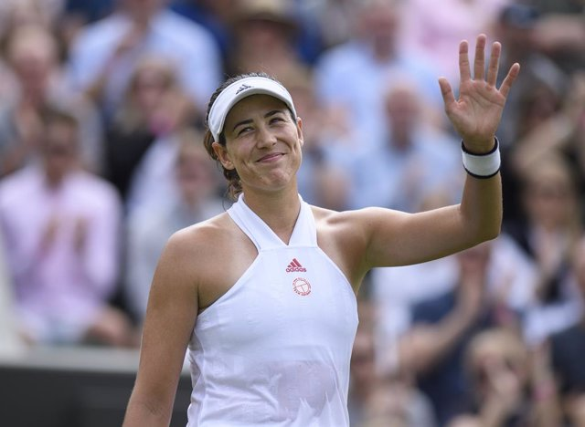 28 June 2021, United Kingdom, London: Spanish tennis player Garbine Muguruza celebrates victory after defeating France's Fiona Ferro in their women's singles first round match on day one of the 2021 Wimbledon Tennis Championships at The All England Lawn T