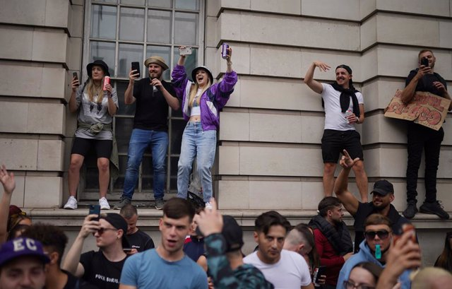27 June 2021, United Kingdom, London: People gather in Whitehall Street during a #FreedomToDance march organised by Save Our Scene, in protest of the government's perceived disregard for the live music industry throughout the coronavirus pandemic. Photo: