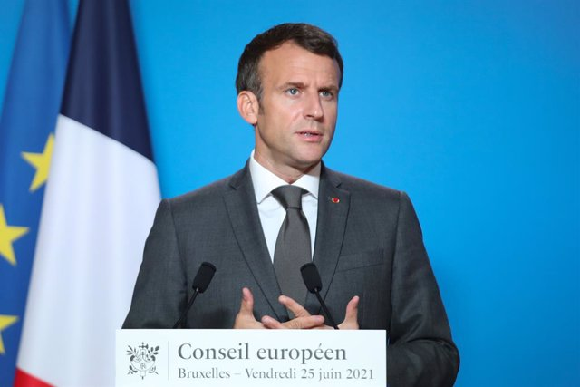 HANDOUT - 25 June 2021, Belgium, Brussels: French President Emmanuel Macron speaks during a press conference after a two-days European Union summit at the European Council. Photo: Mario Salerno/European Council/dpa - ATTENTION: editorial use only and only