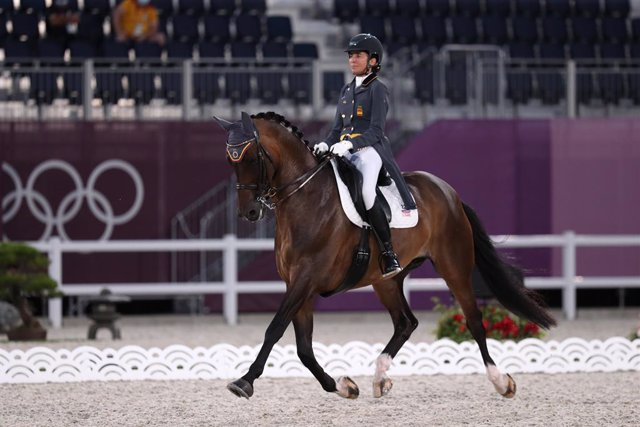 24 July 2021, Japan, Tokyo: Spain's Beatriz Ferrer-Salat riding Elegance competes in the Dressage Individual Grand Prix qualification round at the Baji Koen Equestrian Park, during the Equestrian events of the  Tokyo 2020 Olympic Games. Photo: Friso Gents