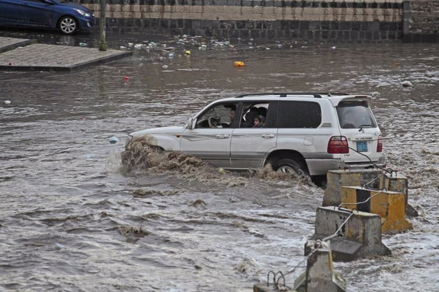 23 July 2021, Yemen, Sanaa: A motorist drives in a flooded street after heavy rains in Sanaa. At least fourteen people have been killed by flooding in Yemen after nonseasonal rainstorms hit parts of the country, security officials said. Photo: Hani Al-Ans