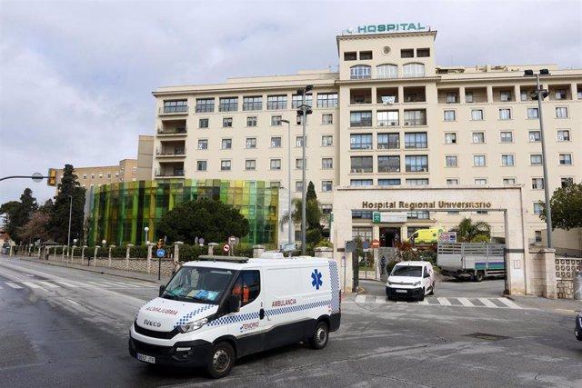 Archivo - Imagen de archivo de una ambulancia saliendo del del Hospital Regional de Málaga