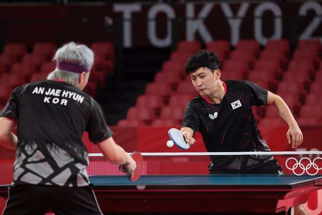 20 July 2021, Japan, Tokyo: South Korean table tennis players Jeoung Young-sik (R) and An Jae-hyun train at Tokyo Metropolitan Gymnasium ahead of the Tokyo 2020 Olympic Games set to place place between 23 July until 08 August 2021. Photo: -/YNA/dpa