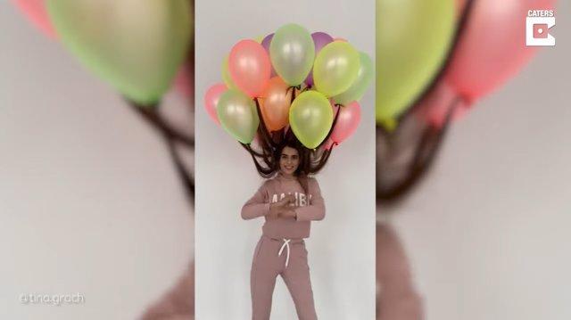 Esta ucraniana de 23 años se roba todas las miradas con su extravagante peinado hecho con una docena de globos de helio