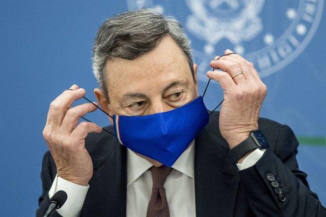 22 July 2021, Italy, Rome: Italian Prime Minister Mario Draghi puts on his face mask during a press conference at Chigi Palace government office. Photo: Roberto Monaldo/LaPresse via ZUMA Press/dpa