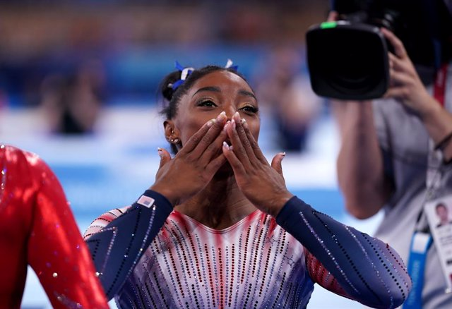 03 August 2021, Japan, Tokyo: USA's Simone Biles reacts after winning bronze in the Women's Balance Beam Final of the Artistic Gymnastics competition at the Ariake Gymnastics Centre during the Tokyo 2020 Olympic Games. Photo: Mike Egerton/PA Wire/dpa
