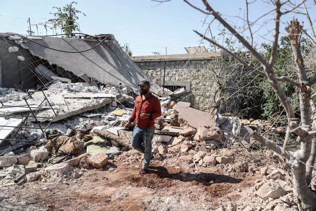 22 July 2021, Syria, Iblin: A man inspects a destroyed house after it was targeted by a missile shelling carried out by the Syrian government at the village of Iblin in Idlib. At least seven civilians, all from the same family, were killed on Thursday aft