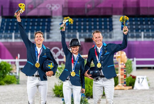 Team Sweden on the podium. (L to R): Henrik von Eckermann, Malin Baryard-Johnsson and Peder Fredricson. Almost a century since Sweden last won Olympic Jumping Team gold and tonight they did it with both style and grace at the Tokyo 2020 Olympic Games in B