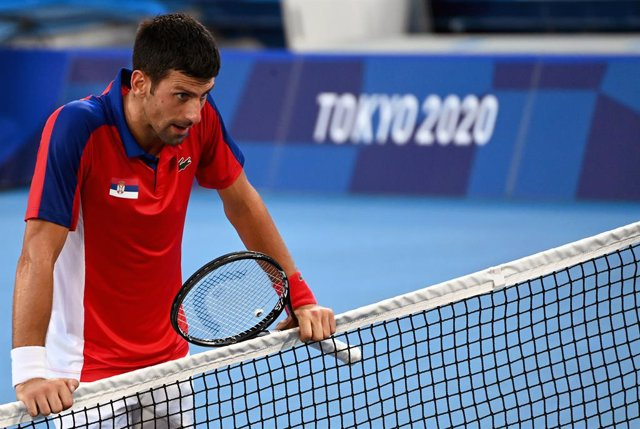 31 July 2021, Japan, Tokyo: Serbian tennis player Novak Djokovic reacts after being defeated against Spain's Pablo Carreno Busta in the Men's Singles Bronze Medal Match at the Ariake Tennis Centre Court, during the Tokyo 2020 Olympic Games. Photo: Marijan