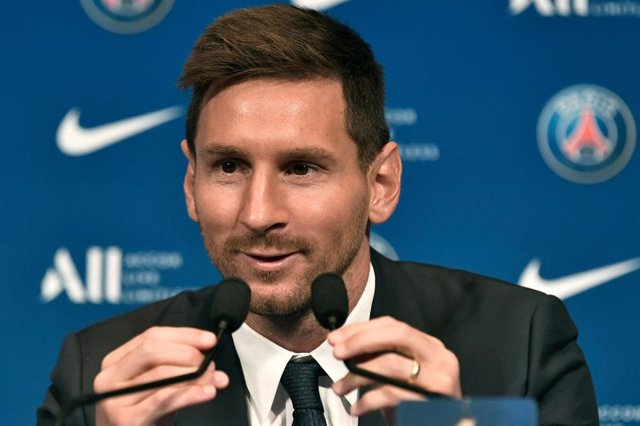 Argentinian football player Lionel Messi speaks during his unveiling at the French football club Paris Saint-Germain's (PSG) Parc donis Princes stadium. Messi signed a two-year deal with PSG, with the option of an additional year