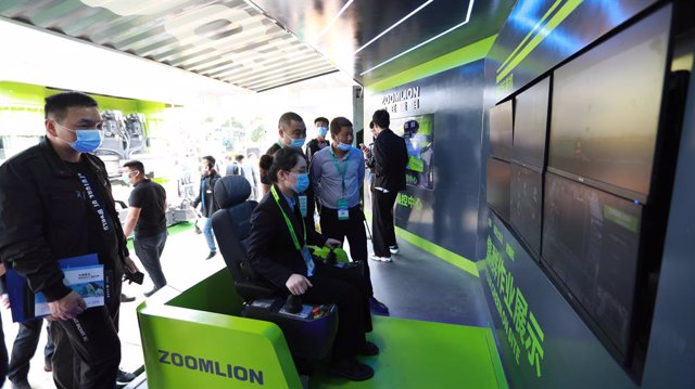 A Zoomlion employee demonstrates its 5G Tower Crane Remote Intelligent Control System at the 2021 Changsha International Construction Equipment Exhibition (CICEE)