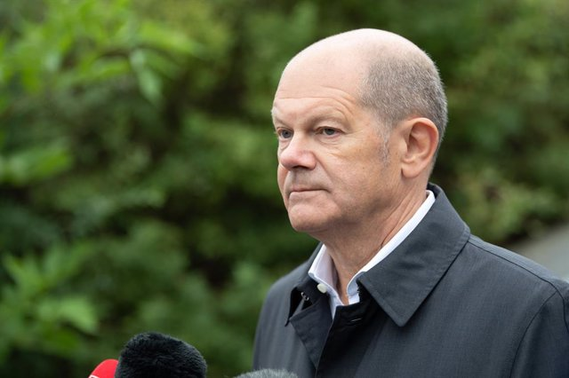 17 August 2021, Brandenburg, Grosskoschen: Olaf Scholz, German Minister of Finance and candidate of the Social Democratic Party (SPD)for German Chancellor, speaks to media as he arrives at the Senftenberg Lake Family Park. Scholz is visiting Lusatia on t