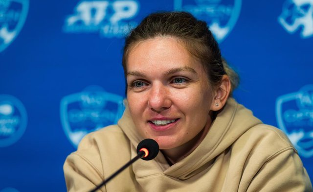 Simona Halep of Romania talks to the media after winning her first round match at the 2021 Western & Southern Open WTA 1000 tennis tournament