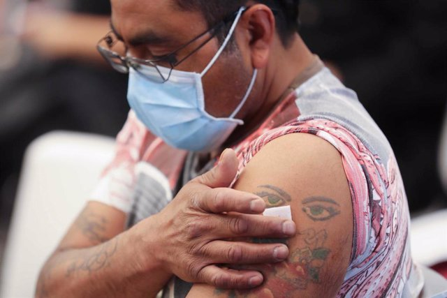 FILED - 06 August 2021, Mexico, Toluca: A man holds his arm after he received his dose of coronavirus vaccine jab during a vaccination campaign at a medical centre. Photo: -/El Universal via ZUMA Press Wire/dpa