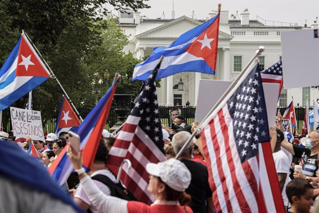 26 July 2021, US, Washington: Cubans gather at Lafayette Park in front of the White House to demand USPresident Joe Biden provide humanitarian help to their country and to intervene in Cuba during a rally against the Cuban government. Photo: Lenin Nolly/