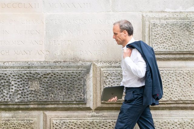 20 August 2021, United Kingdom, London: UK Secretary of State Dominic Raab arrives at the Foreign Office in Westminster, London. Raab faces mounting pressure to resign after not interrupting his holiday on the Greek island of Crete to make a phone call to