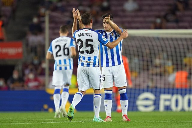 15 August 2021, Spain, Barcelona: Real Sociedad's Julen Lobete (R) celebrates scoring his side's first goal with teammate  Jon Bautista during the Spanish LaLiga soccer match between FC Barcelona and Real Sociedad at Camp Nou Stadium. Photo: -/LaPresse vi