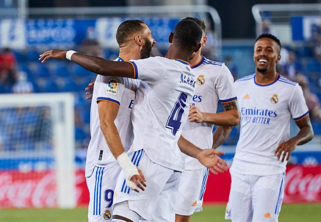 Karim Benzema of Real Madrid CF celebrates a goal with teammates during the Spanish league, La Liga Santander, football match played between Deportivo Alaves and Real Madrid CF at Mendizorroza stadium on August 14, 2021 in Vitoria, Spain.