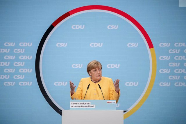 21 August 2021, Berlin: German Chancellor Angela Merkel speaks on stage at the kick-off of the CDU/CSU's central election campaign at the Tempodrom Berlin venue. Photo: Michael Kappeler/dpa