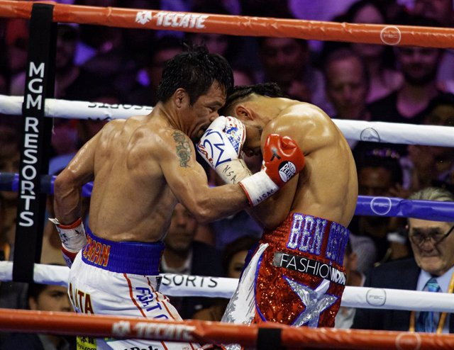 Archivo - 20 July 2019, US, Las Vegas: Filipino professional boxer Manny Pacquiao (L) and USAboxer Keith Thurman in action during the WBA World Welterweight title fight. Photo: Larry Burton/ZUMA Wire/dpa