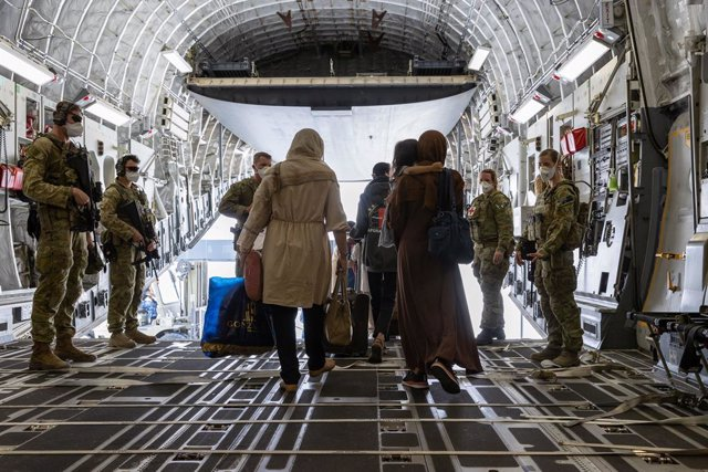 A supplied image obtained on Sunday, August 22, 2021, of Afghanistan evacuees arrive at Australia's main operating base in the Middle East, on board a Royal Australian Air Force C-17A Globemaster. Further flights into Kabul are being carefully planned as