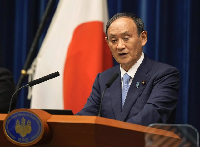 17 August 2021, Japan, Tokyo: Japanese Prime Minister Yoshihide Suga speaks during a press conference at the Prime Minister's Official Residence in Tokyo. Suga announced the extension of   Coronavirus state of emergency in six prefectures including Tokyo