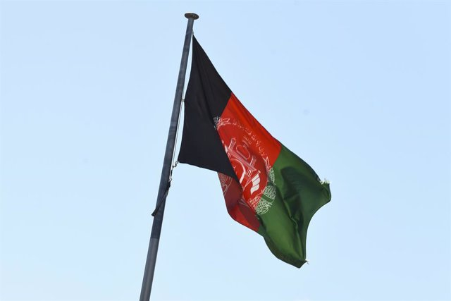 The Afghan flag is seen flying at the Embassy of the Islamic Republic of Afghanistan in Canberra, Monday, August 16, 2021. (AAP Image/Lukas Coch) NO ARCHIVING