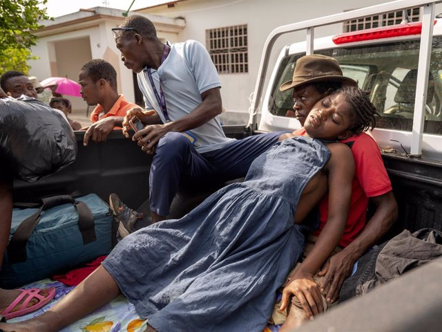 20 August 2021, Haiti, Barnate: A 14-year-old girl in advanced labor is transported in the back of a pickup truck from a mobile medical clinic in the small village of Barnate in southwestern Haiti near the epicentre of last week's earthquake. The girl too