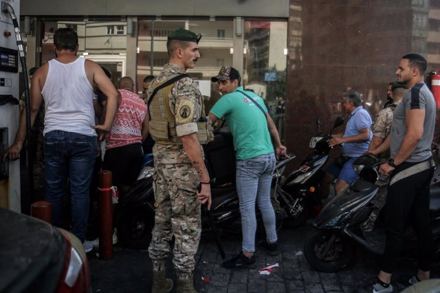 14 August 2021, Lebanon, Beirut: A Lebanese army soldier supervises entry of motorists and vehicles at a gas station in Beirut to curb fuel hoarding, as central bank chief Riad Salamehannounced this week that he would no longer be able to subsidize fuel