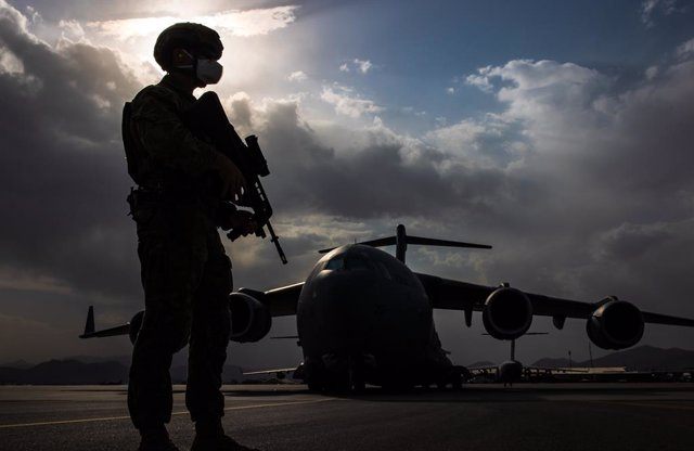 A supplied image obtained on Monday, August 23, 2021, of Royal Australian Air Force Airfield Defence Guards provide aircraft security at Hamid Karzai International Airport, Kabul, as Australian citizens and visa holders prepare to be evacuated from Afghan