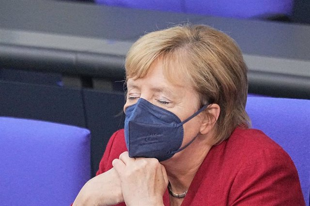 25 August 2021, Berlin: German Chancellor Angela Merkel sits with her eyes closed at the special session of the German Bundestag on the situation in Afghanistan. Photo: Michael Kappeler/dpa