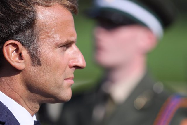26 August 2021, Ireland, Dublin: French President Emmanuel Macron inspects a Guard of Honour at Aras an Uachtarain during a ceremonial welcome. Photo: Brian Lawless/PA Wire/dpa