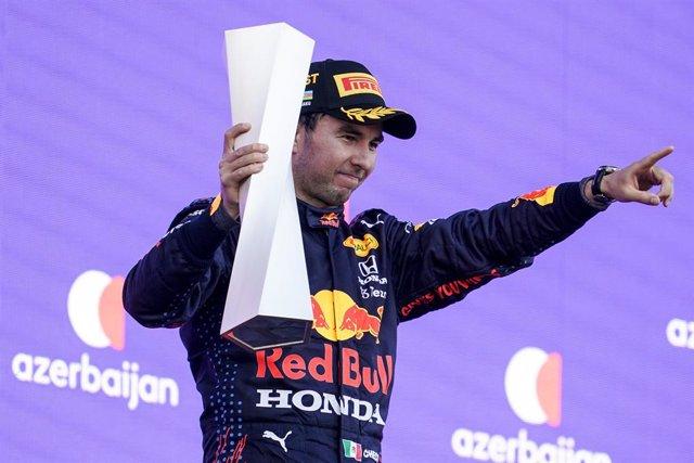 Archivo - 06 June 2021, Azerbaijan, Baku: Mexican F1 Driver Sergio Perez of Red Bull Racing celebrates on the podium after winning the Formula 1 Grand Prix of Azerbaijan at the Baku City Circuit. Photo: James Gasperotti/ZUMA Wire/dpa