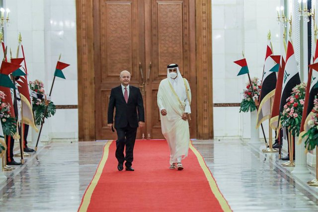 28 August 2021, Iraq, Baghdad: Iraqi President Barham Salih (L), welcomes at the Emir of Qatar Sheikh Tamim bin Hamad Al Thani at the Baghdad's Presidential Palace ahead of Baghdad Cooperation and Partnership Conference. Photo: Ameer Al Mohammedaw/dpa