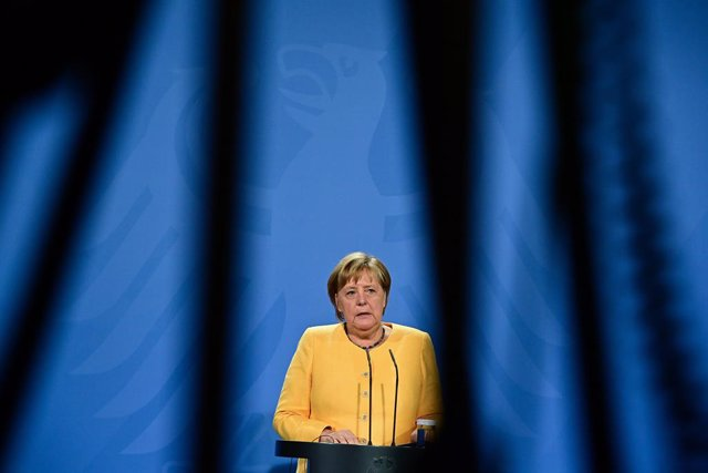 27 August 2021, Berlin: German Chancellor Angela Merkel speaks at a press conference after the G20 Compact with Africa conference at the Chancellery. Photo: Tobias Schwarz/AFP POOL/dpa
