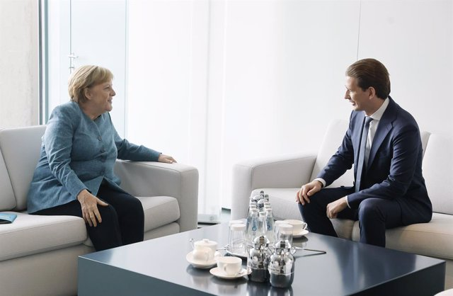 HANDOUT - 31 August 2021, Berlin: German Chancellor Angela Merkel (L) meets with Austrian Chancellor Sebastian Kurz at the Federal Chancellery. Photo: Dragan Tatic/BUNDESKANZLERAMT via APA/dpa - ATTENTION: editorial use only and only if the credit mention