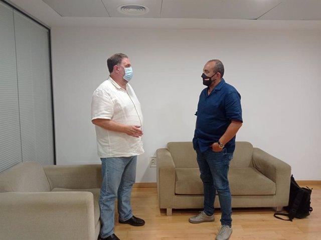 El presidente de ERC, Oriol Junqueras, y el secretario general de CC.OO. De Catalunya, Javier Pacheco, este martes