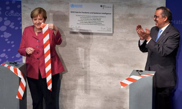 """Berlin: Tedros Adhanom Ghebreyesus, Director-General of the World Health Organization (WHO), and German Chancellor Angela Merkel symbolically cut a ribbon at the inauguration ceremony of the """"WHO Hub For Pandemic And Epidemic Intelligence""""."""