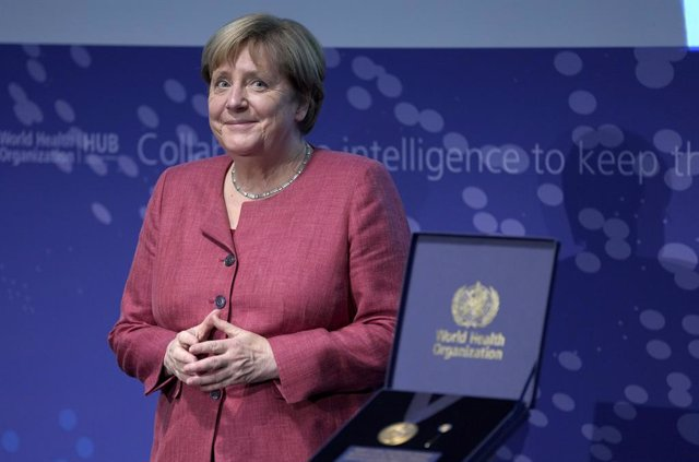 """01 September 2021, Berlin: German Chancellor Angela Merkel smiles before receiving a medal from the Director-General of the World Health Organization (WHO) during the inauguration ceremony of the """"WHO Hub For Pandemic And Epidemic Intelligence"""". The hub i"""