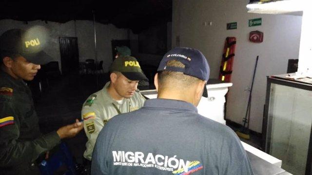 Archivo - Agentes de Migración Colombia