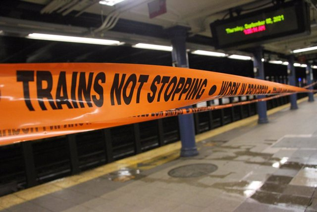 01 September 2021, US, New York: A barrier tape hangs on a railway track in a subway station after heavy rainfall. Due to heavy flooding after a storm, the city of New York has imposed a travel ban within the metropolis of millions. Photo: Niyi Fote/TheNE