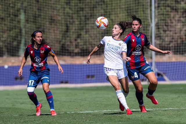 Esther Gonzalez of Real Madrid and Maria Mendez of Levante in action during the Spanish League Womens  Iberdrola football match played between Levante UD Femenino and Real Madrid Club de Futbol.In the sports city of Levante in Bunol. On September 5, 2021